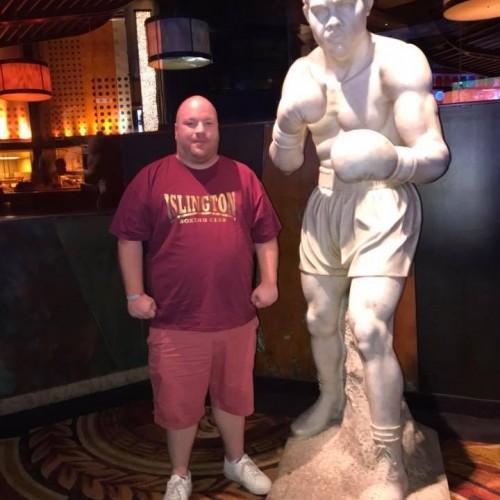 Reggie with Joe Louis Statue in Caesars Palace, Las Vegas