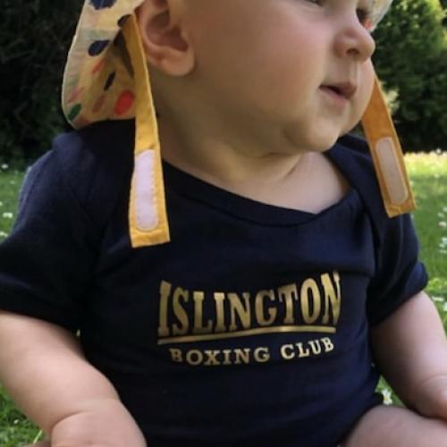 Coach Rider's Baby in a custom IBC baby grow